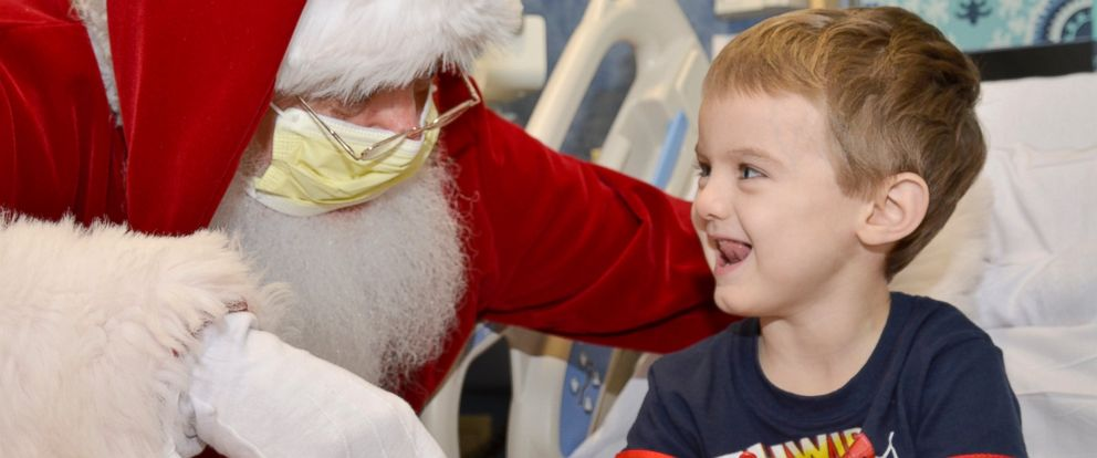 PHOTO: Santa hung out with this little guy at the Jimmy Fund Clinic in Boston.