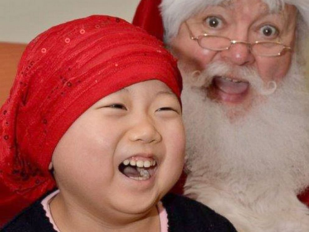 PHOTO: Santa and this little girl at the Jimmy Fund Clinic were competing for biggest smile.