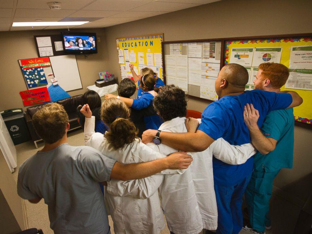 PHOTO: Texas Health Presbyterian Hospital Dallas staff gather to watch Amber Vinson speak