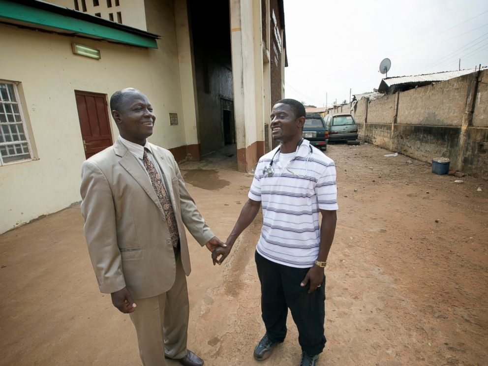 PHOTO: Dr. Martin Salia (right) visits with Bishop John K. Yambasu