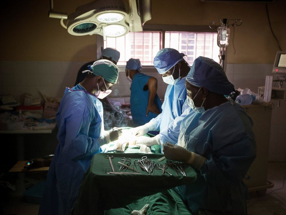 PHOTO: Dr. Martin Salia, left, performs surgery at the United Methodist Churchs Kissy Hospital