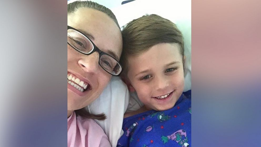 Kerri Evensen poses with her son Auden in the hospital.
