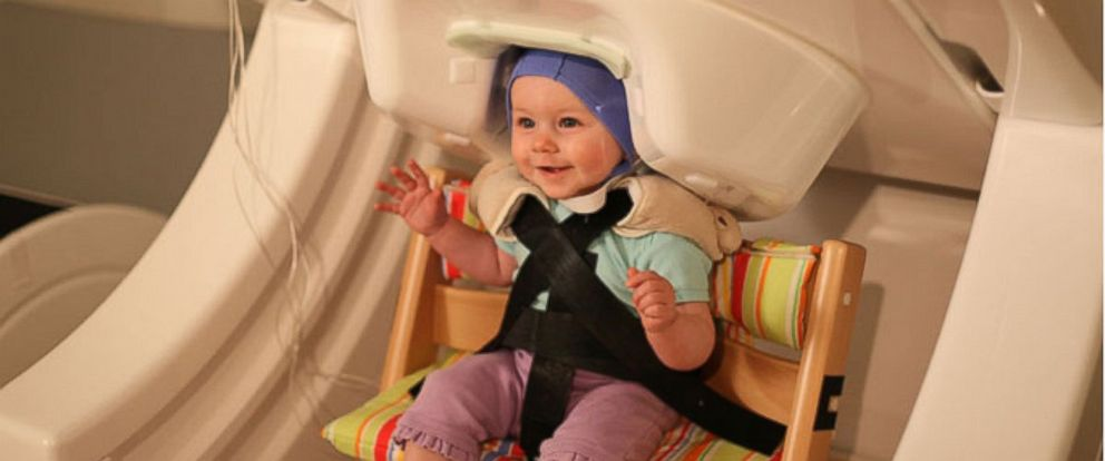 PHOTO: Researchers use a special machine called a magnetoencephalograph to see infants brain activity.