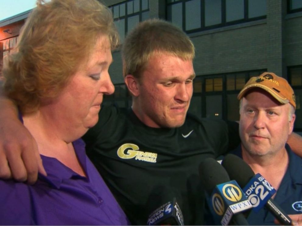PHOTO: Noah Cornuets parents and his older brother, Shane, mourn at a vigil.