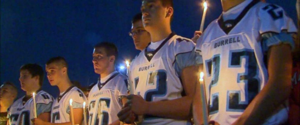 PHOTO: Burrell High School football players mourn at a vigil for Noah Cornuet.