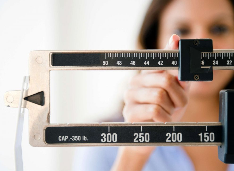 PHOTO: A woman uses a weight measure in this undated stock photo.