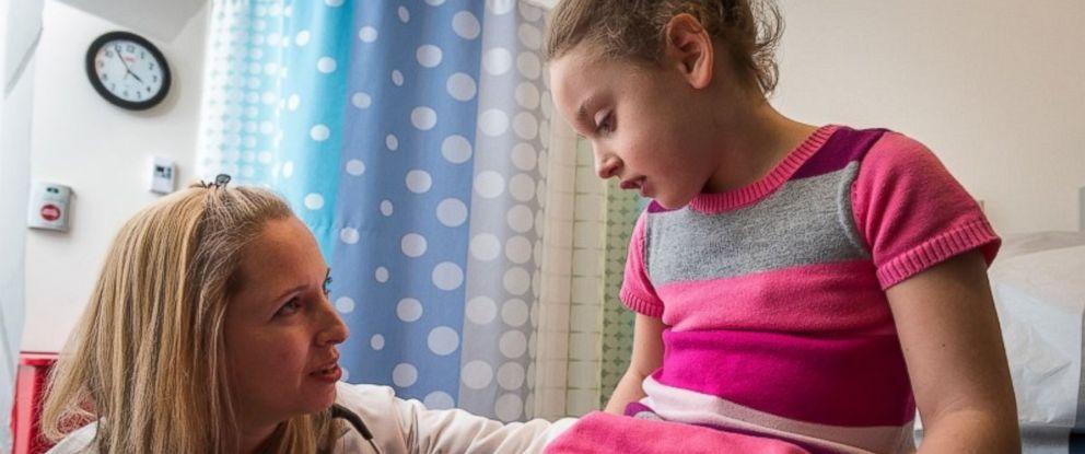 PHOTO: Pediatric patient Allison Schablein being examined by nurse Maryann Zimmerman, CPNP.