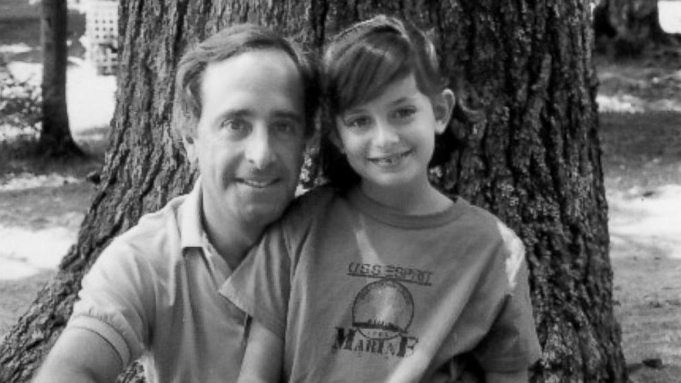 Carrie Davis is shown here in a childhood photo with her father John Davis.