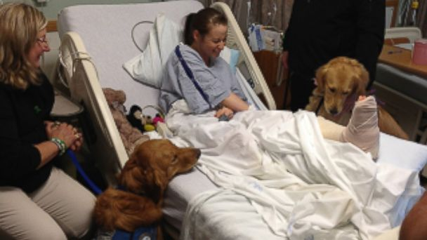 PHOTO: The Lutheran Church Charities K-9 Parish Comfort Dogs visited with a survivor of the Boston bombings in the hospital just before she went in for leg surgery.