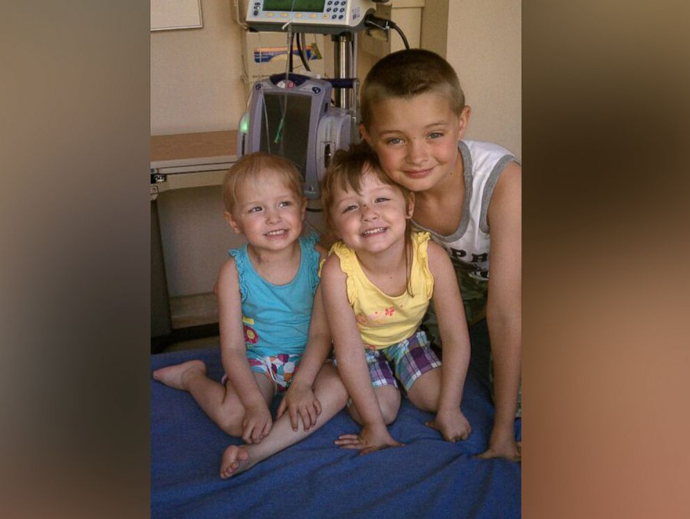 PHOTO: Elizabeth and Kathryn Girtler of Minnesota City, Minnesota, are seen here with their brother, LeeRoy.