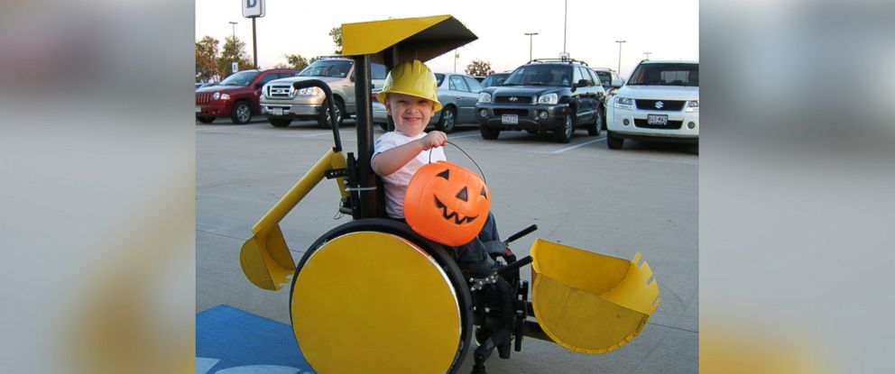 """PHOTO: Caleb McLelland is pictured here at age 3 as """"Bob the Builder"""" in a """"Backhoe/Scoop truck"""" wheelchair costume designed by his mother Cassie McLelland for Halloween 2008."""