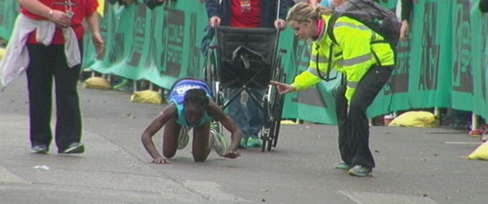 PHOTO: Elite runner Hyvon Ngetich had to crawl across the finish line in the Austin Marathon after her body gave out, Feb. 15, 2014.