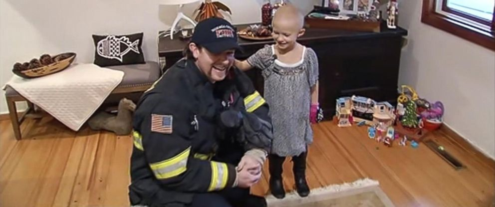 PHOTO: Firefighters escort a girl to her last chemotherapy appointment.