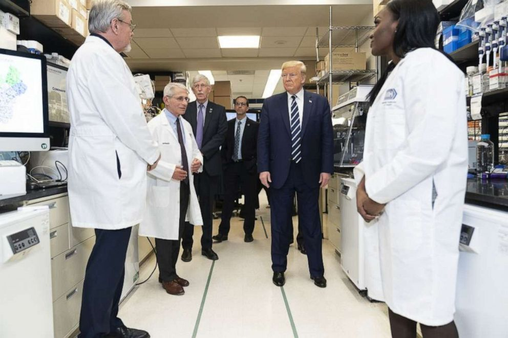 PHOTO: President Trump visits the biological lab, March 3, 2020, at the National Institutes of Health, with Dr. Anthony Fauci, 2nd-left, and Dr. Kizzmekia Corbett, right.
