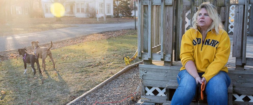 PHOTO: Danette Lake sits on her front porch after walking her dogs. A doctor told Lake that knee replacement surgery could reduce her arthritis pain by 75 percent. One year after the surgery, however, shes still in extreme pain and unable to work.