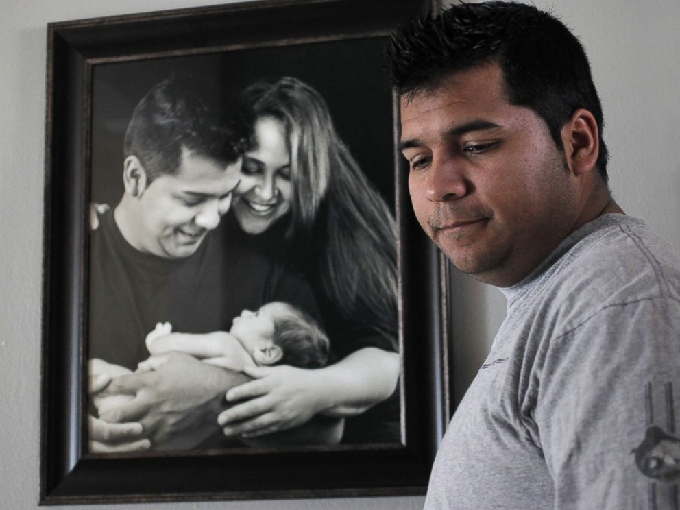 PHOTO: Erick Munoz, the husband of Marlise Munoz, stands near a photo of himself and his wife