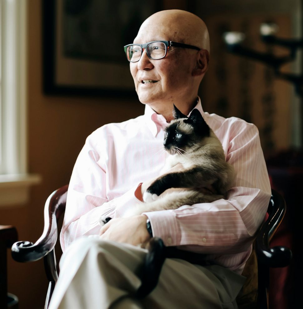 PHOTO: Naito cuddles his cat, Dolly, at his Portland, Ore., home in May 2019. The poor delivery of Naito's diagnosis with stage 4 pancreatic cancer left him determined to share his experience with future physicians.
