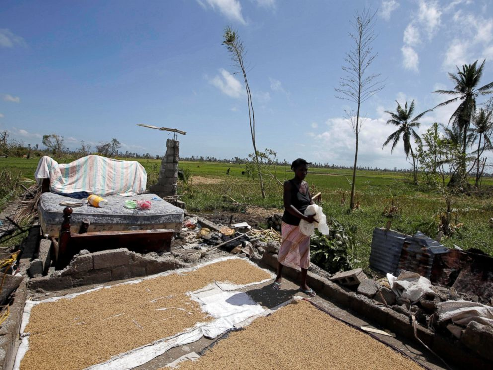 PHOTO: A woman walks on the remains of her house destroyed by Hurricane Matthew on the outskirts of Les Cayes, Haiti, Oct. 7, 2016.
