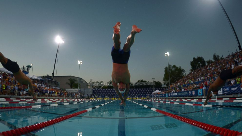 Anthony Ervin dives into the pool at the start of the 50m freestyle in the 2014 USA National Championships at William Woollett Jr. Aquatics Complex in Irvine, Calif., Aug. 10, 2014.