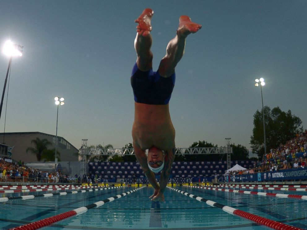 PHOTO: Anthony Ervin dives into the pool at the start of the 50m freestyle