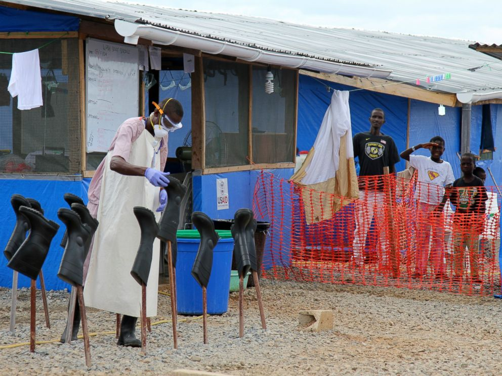 PHOTO: People stand in the red zone where they are being treated for Ebola at the Bong County Ebola Treatment Unit in Monrovia, Liberia, Oct. 28, 2014.