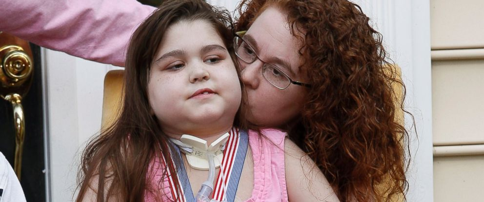 PHOTO: Sarah Murnaghan sits on her mother Janets lap outside their home in Newtown Square, Penn.
