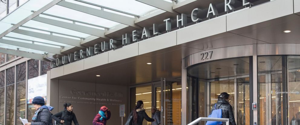 People enter New York City Health Hospitals Gouverneur Health building, Tuesday, Jan. 8, 2019, in New York. Mayor Bill de Blasio says New York City will spend up to $100 million per year to expand health care coverage to people without health insuran