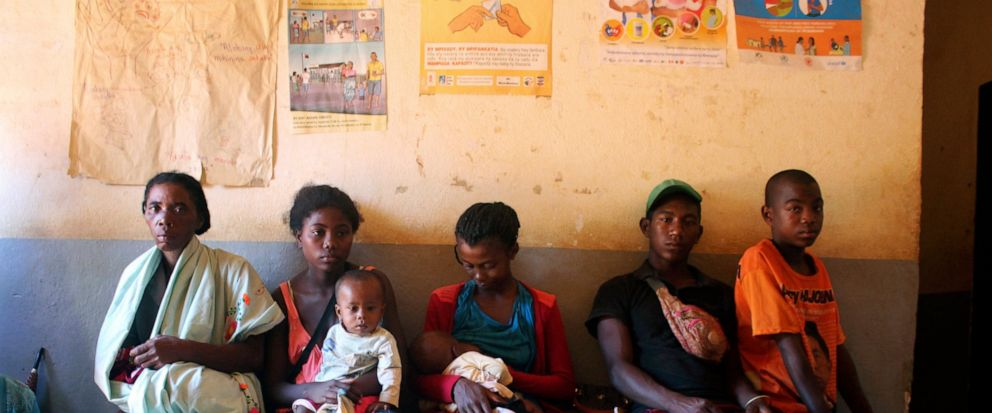 In this photo taken Thursday, March 21, 2019, mothers wait to have their babies vaccinated against measles, at a healthcare center in Larintsena, Madagascar. As the island nation faces its largest measles outbreak in history and cases soar well beyon