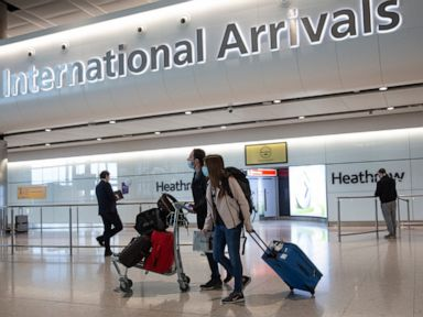 England to cut travel quarantines to 5 days with tests