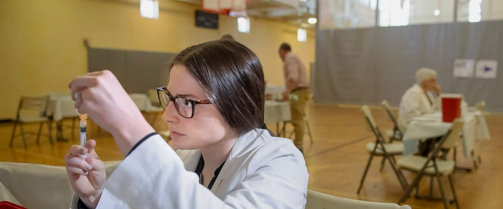 FILE - In this Wednesday, May 8, 2019 file photo, University of Pittsburgh pharmacy student Alexandria Taylor prepares syringes during a free measles vaccination clinic by the Allegheny County Health Department at the Homewood-Brushton YMCA in Pittsb