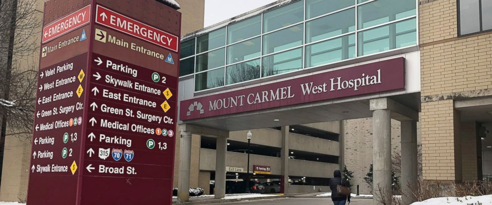 FILE - In this Jan. 15, 2019 file photo, the main entrance to Mount Carmel West Hospital is shown in Columbus, Ohio. The Ohio hospital system where an intensive-care doctor is accused of ordering painkiller overdoses for dozens of patients says it ha