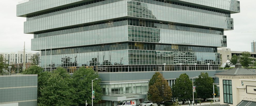 Cars pass Purdue Pharma headquarters Thursday, Sept. 12, 2019, in Stamford, Conn. For months, the judge overseeing national litigation over the opioids crisis urged all sides to reach a settlement that could end thousands of lawsuits filed by state a