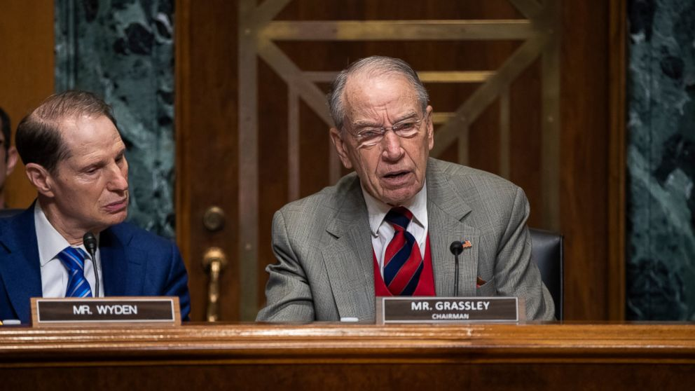 Sen. Chuck Grassley, R-Iowa, center, chairman of the Senate Finance Committee, is joined at left by Sen. Ron Wyden, D-Ore., the ranking member, at a hearing on the high price of prescription drugs, on Capitol Hill in Washington, Tuesday, Jan. 29, 2019. (AP Photo/J. Scott Applewhite)