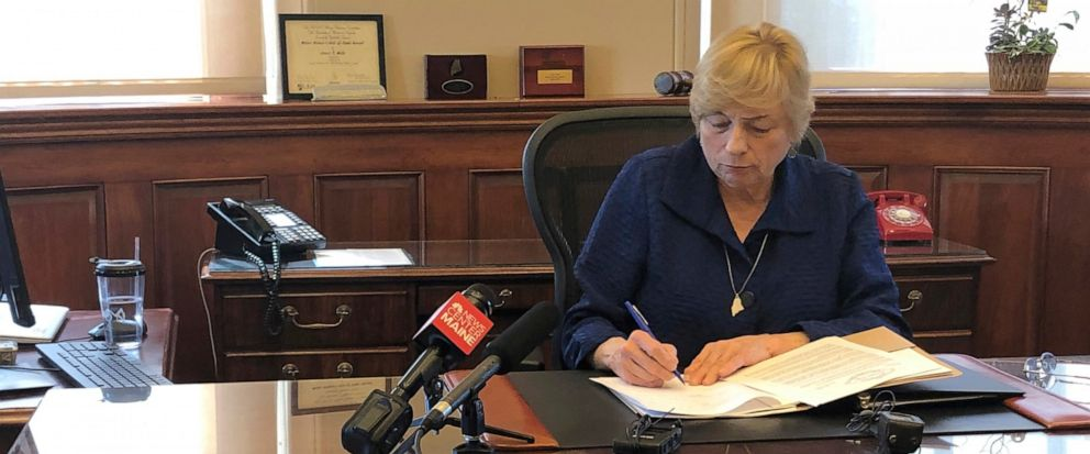 Maine Democratic Gov. Janet Mills signs a bill Wednesday, June 12, 2019, in her office in Augusta, Maine, becoming the eighth state to allow terminally ill people to end their lives with prescribed medication. (AP Photo/Marina Villeneuve)
