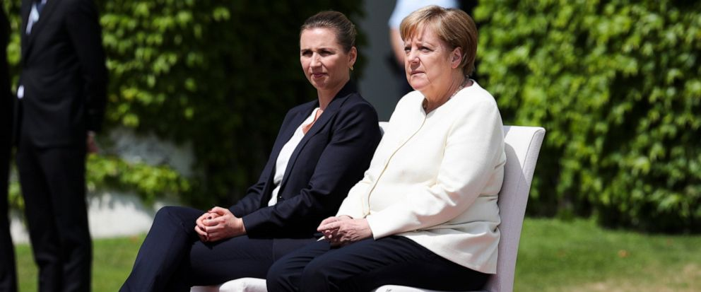 German Chancellor Angela Merkel, right, and Danish Prime Minister Mette Frederiksen, left, sit on chairs as they listen to the national anthems prior to a meeting at the chancellery in Berlin, Thursday, July 11, 2019. German Chancellor and the visiti