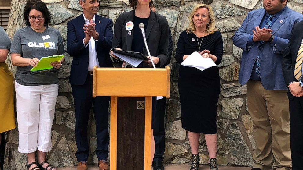 "Arizona Superintendent of Public Instruction Kathy Hoffman speaks during a press conference celebrating the repeal of a 1991 state law that bars HIV and AIDS instruction that ""promotes a homosexual lifestyle"" on Thursday, April 11, 2019, in Phoenix. Lawmakers passed a repeal bill this week and Gov. Doug Ducey quickly signed it on Thursday in a move intended to end a discrimination lawsuit filed by LGBTQ groups. (AP Photo/Jonathan J. Cooper)"