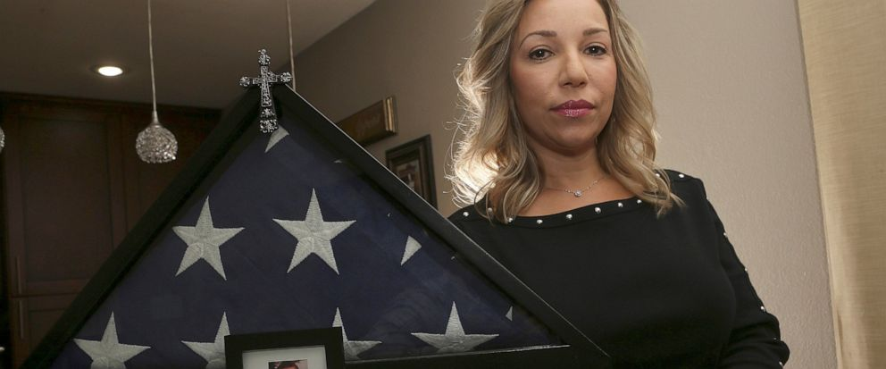 Rebecca Tiger, a former Phoenix police officer, is the widow of Craig Tiger, a Phoenix police officer who committed suicide a few years ago following a fatal shooting he was involved in, shown her home Monday, July 1, 2019, in Scottsdale, Ariz. Offic