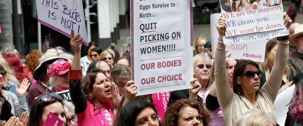 FILE - In this May 21, 2019 file photo, people rally in support of abortion rights at the Capitol in Sacramento, Calif. Gov. Gavin Newsom signed a measure, on Friday, Oct. 11,2019, that will require public colleges and universities to offer abortion