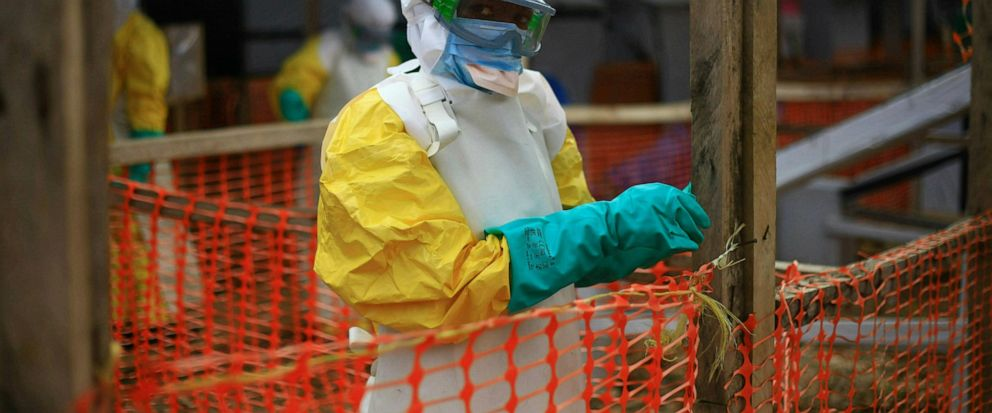 FILE - This Tuesday, April, 16, 2019 file photo taken in Congo shows an Ebola health worker at a treatment center in Beni, Eastern Congo. Ugandas health ministry said late Tuesday, June 11, 2019 that a 5-year-old Congolese boy who crossed into Ugand