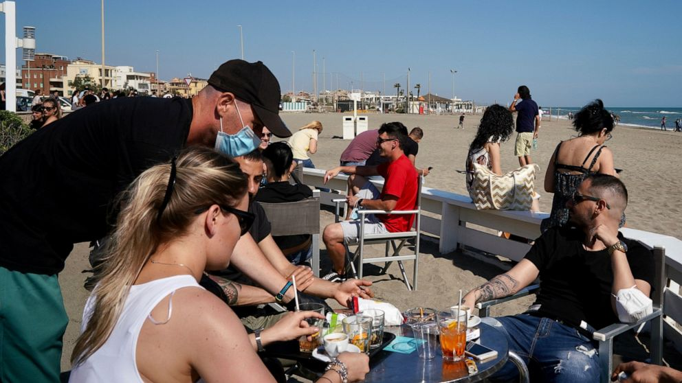 Europeans soak up the sun but virus travel rules a mishmash
