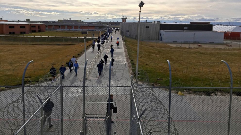 FILE - In this Jan. 30, 2018 file photo, inmates walk across the grounds of the Idaho State Correctional Institution in Kuna, Idaho. Idaho transgender inmate Adree Edmo has spent most of her prison term at this men's prison facility. Idaho said Wednesday, Jan. 9, 2019, it will appeal a recent court ruling ordering the state to provide gender confirmation surgery to Edmo. The Idaho Department of Correction filed a notice advising U.S. District Judge B. Lynn Winmill that the state will appeal his ruling to the 9th U.S. Circuit Court of Appeals. (AP Photo/Rebecca Boone, File)