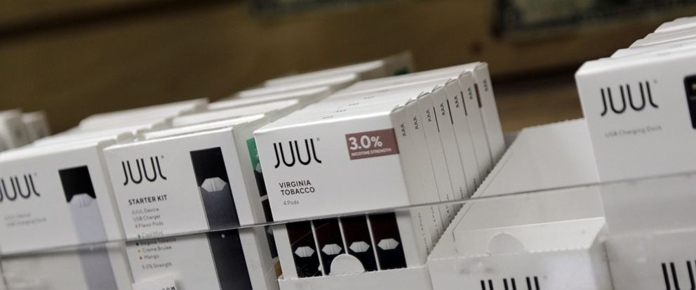 FILE - This Thursday, Dec. 20, 2018, file photo shows Juul products for sale. North Carolina's attorney general has filed a lawsuit against the popular e-cigarette maker JUUL, asking a court to limit what flavors it can sell and ensure underage teens