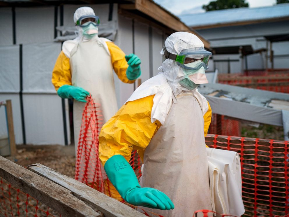 PHOTO: In this photograph taken Saturday July 13, 2019, health workers wearing protective suits take their shift at a treatment center in Beni, Congo DRC.