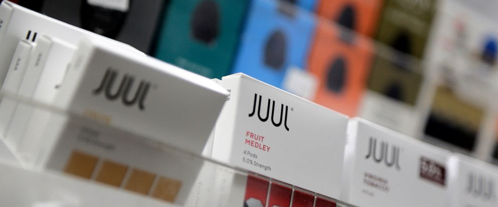 FILE - In this Dec. 20, 2018, file photo Juul products are displayed at a smoke shop in New York. On Thursday, Oct. 3, 2019, the U.S. Federal Trade Commission ordered Juul and five other vaping companies to hand over information about how they market