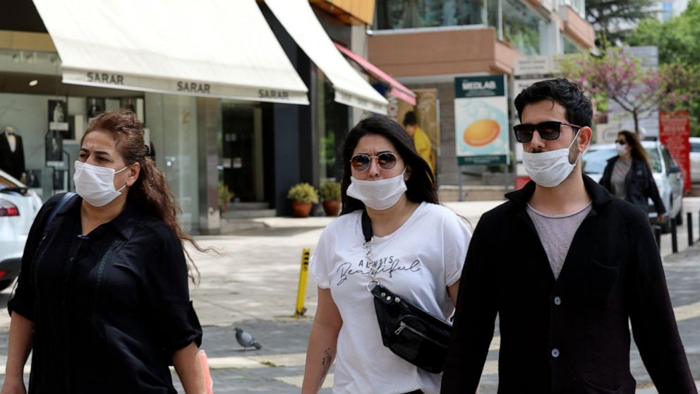 Older Turks enjoy walks outside as coronavirus rules relaxed thumbnail