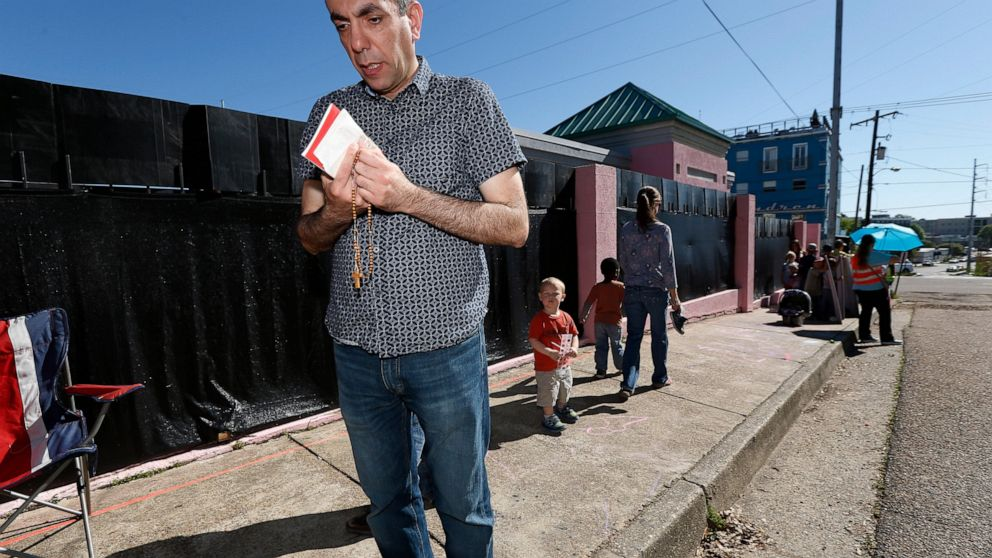 An abortion opponent prays outside the Jackson Women's Health Organization clinic in Jackson, Miss., on Wednesday, April 10, 2019. It is the only medical facility that performs abortions in the state. The state legislature recently passed a law that would ban most abortions after a fetal heartbeat is detected, meaning as early as six weeks. (AP Photo/Rogelio V. Solis)
