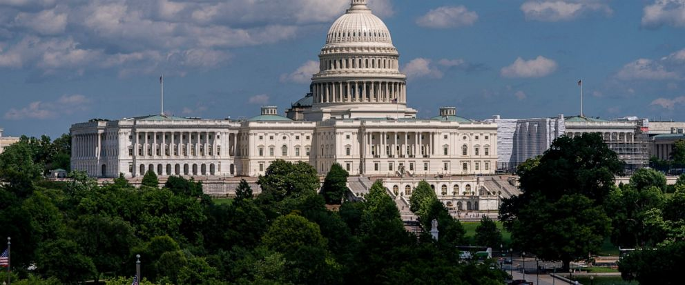 FILE - In this June 20, 2019, file photo, the Capitol is seen from the roof of the Canadian Embassy in Washington. America's much-maligned health care system is covering more people than ever, a fact lost on many of the 2020 presidential candidates,