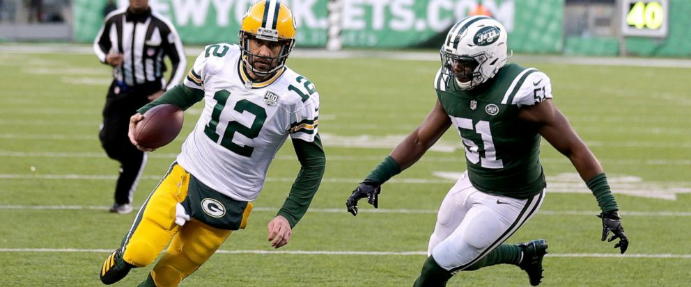 FILE - In this Dec. 23, 2018, file photo, Green Bay Packers quarterback Aaron Rodgers runs for a touchdown as New York Jets outside linebacker Brandon Copeland (51) chases him during the second half of an NFL football game in East Rutherford, N.J. Co
