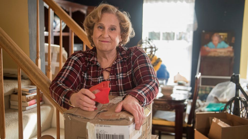 Mary Radnofsky, diagnosed with a rare form of leukoencephalopathy and in the early stages of dementia, prepares for her move to a new home that will be more suitable for her declining health, on Friday, Jan. 18, 2019, in Alexandria, Va. Faced with an aging American workforce, U.S. companies are increasingly navigating delicate conversations with employees suffering from cognitive declines or dementia diagnoses, experts say. (AP Photo/Kevin Wolf)