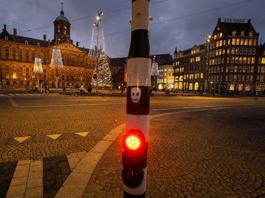 Dutch lawmakers back coronavirus curfew despite criticism